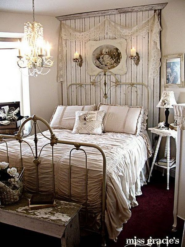 This is an example of a romantic shabby-chic style bedroom with the chandelier and the beadboard panel behind the bed.