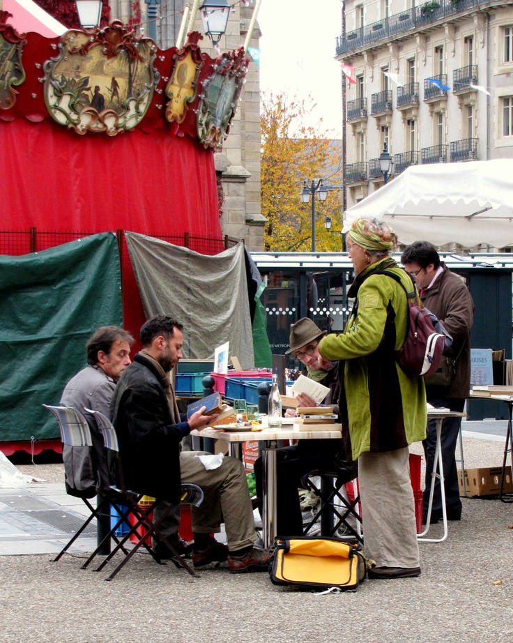 Books are big in France - it is a nation of readers, devouring all genres of books. Used books are always popular and the outdoor book stalls in Rennes receive a steady flow of traffic. But the booksellers must eat and they often do it in style - home cooked meals served on ceramic dishes with flatware. Business continues during the meal but it is an uplifting experience with hot food, literary customers and the music of the carousel.