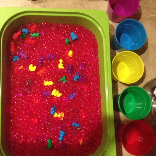 Add color bears to a bin full of water gems (find at dollar store or any craft store for cheap). Children dig for bears and sort colors. Great for sensory exploration, counting, learning colors, etc