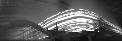 Solargraph Zeeuws Archief: archiefcafé, tuin, abdijtoren Lange Jan. Middelburg, 10 september - 23 december 2010. Pinholecamera: breed blikje.  http://zeeuwsarchief.blogspot.nl/2010/12/solargraph-onthuld-in-tuin-zeeuws.html