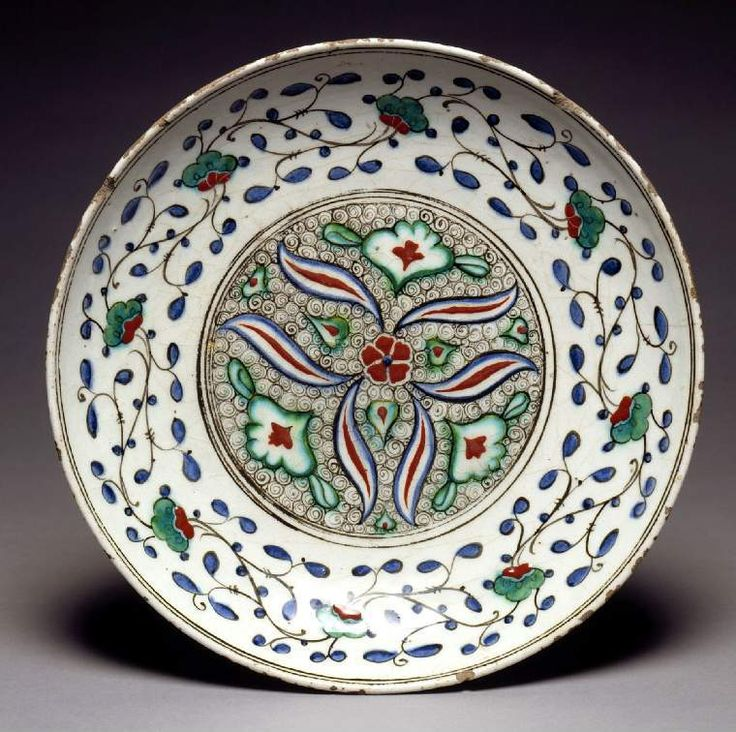 Maker: Unknown; pottery Category: fritware (stonepaste) Name(s): dish Islamic pottery; category Iznik; category Date: circa 1585 — circa 1590 School/Style: Ottoman Period: late 16th Century