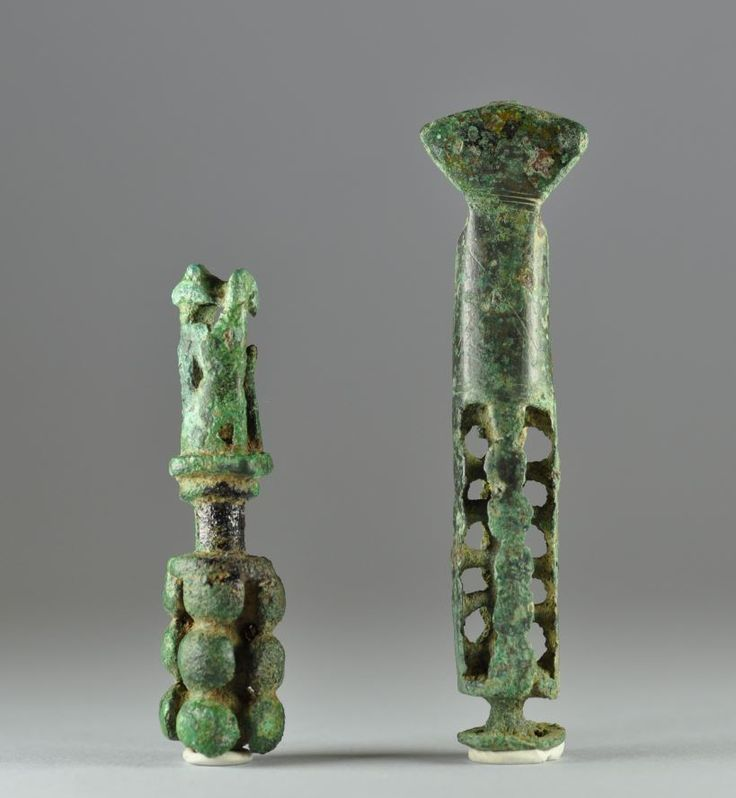 Geometric art, Greek Geometric period bronze stem with a monkey, late 8th century B.C. Greek geometric art, Greek Geometric period bronze stem, these objects appeared in several areas of the Greek peninsula around the late 8th and early 7th century B.C. (Macedonia, Thessaly, Epirus, modern-day Albania, Boeotia, rarely in Laconia) and their meaning remains obscure even if the long accepted hypothesis that interpreted them as jug stoppers is now questioned, 9,1 cm high max. Private collection