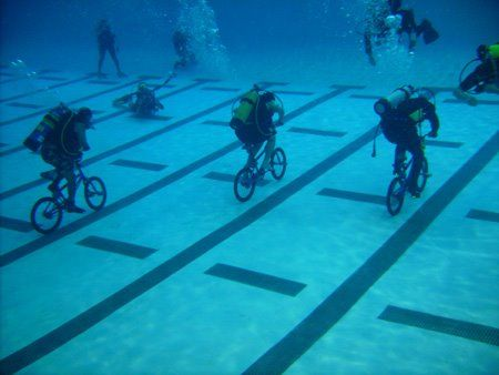 bicycling under water with scuba tanks...we are a crazy insane species!
