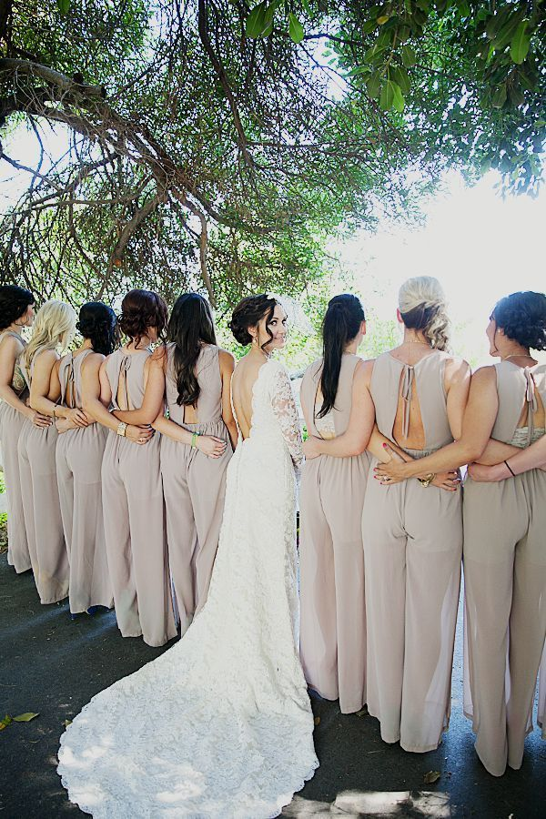 Bridesmaids in pant suits.
