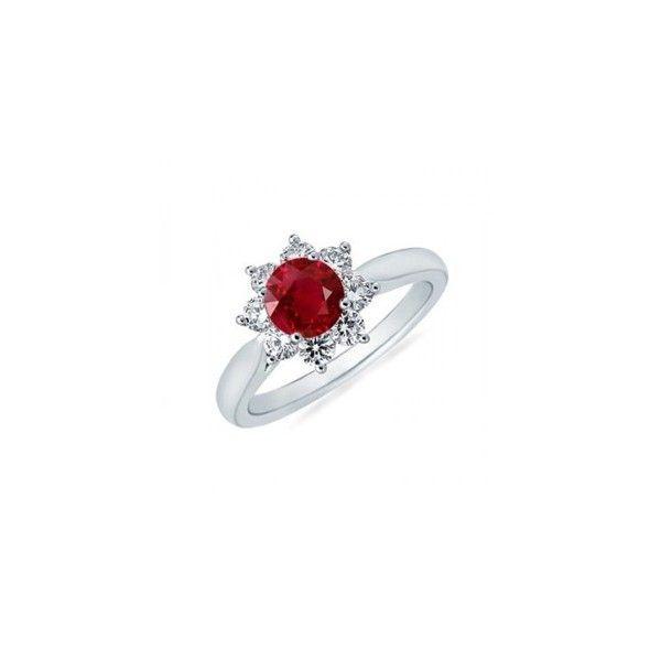 Sofisticado anillo con un rubi birmano rodeado de diamantes que lo adornan dándole un carácter sencillo, pero a la vez muy llamativo por el vivo color rojo de su piedra preciosa y el destello de los diamantes.