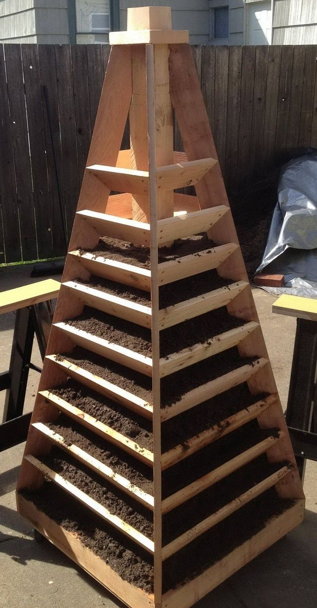 How to build a herb strawberry tower vertical garden for Vertical garden planters diy