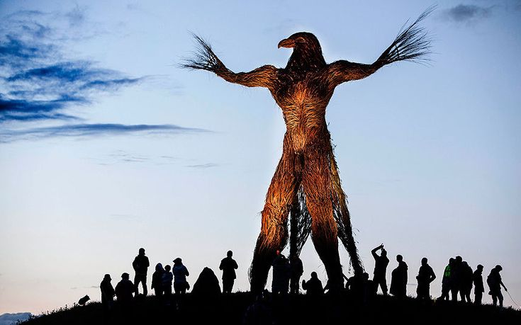 The crowd gathers around a large wooden effigy that will be burnt on the last night of the Wickerman Festival in East Kirkcarswell, Scotland