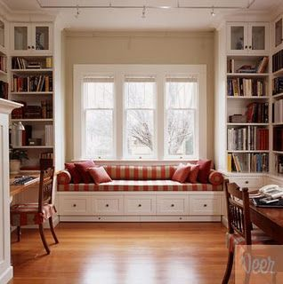 Built-in bench where closet is now. Drawers in bench. Lighting. Cozy reading area.