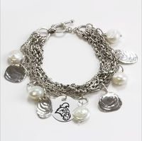 "Often called a Sanibel Island Bracelet these multi strand ""handmade"" chains are complemented by a collection of hand cast sea shells and freshwater pearls. The addition of our high quality, precision detailed Collegiate Charm is a great finishing touch to this magnificent bracelet. Metal: Solid Sterling SilverBracelet Length: 7.25"" to 7.5""Officially Licensed: Yes""The indicia featured on this bracelet is a protected trademark owned by the respective college or universit"