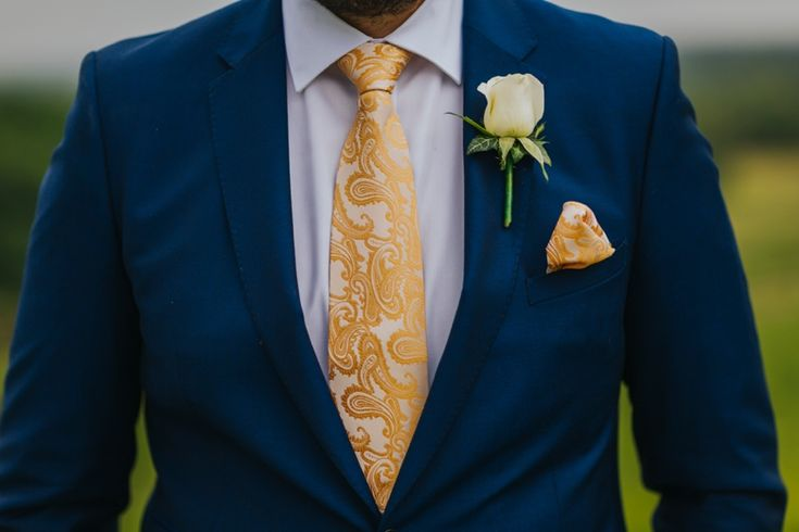 For something a bit more elegant and different than the status quo, try an embroided patterned tie and pocket-square with a block colour suit and shirt. Love this. Photo by Benjamin Stuart Photography #weddingphotography #groom #groomsmen #navysuit #goldtheme #goldwedding #goldtie