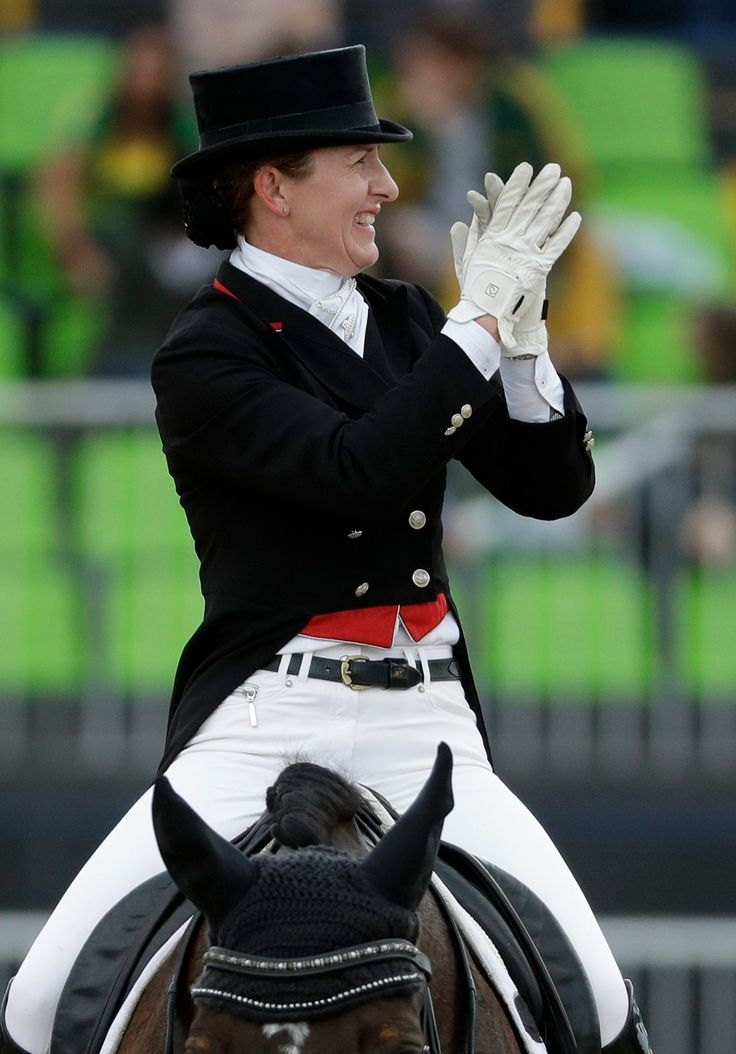 Canada's Belinda Trussell, riding Anton, reacts after competing in the equestrian dressage competition at the 2016 Summer Olympics in Rio de Janeiro, Brazil, Friday, Aug. 12, 2016. (AP Photo/John Locher)