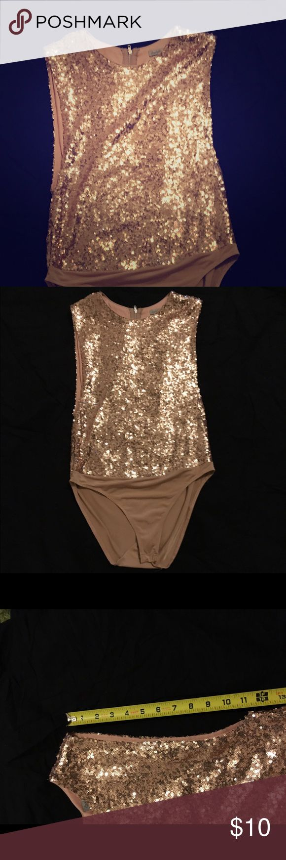 Rose gold leotard Sequence rose gold leotard size M brand Charlotte Russe . It has long openings on the side the picture with the tape measure will give you an idea how long it is . Only worn ones as a regular shirt the openings on the side look very sexy perfect for a night out or for a special event. Feel free to ask any questions!💕 Charlotte Russe Tops Tees - Short Sleeve