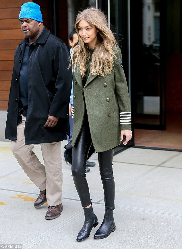 And her minder came, too: The 21-year-old model completed her ensemble with an olive gree...