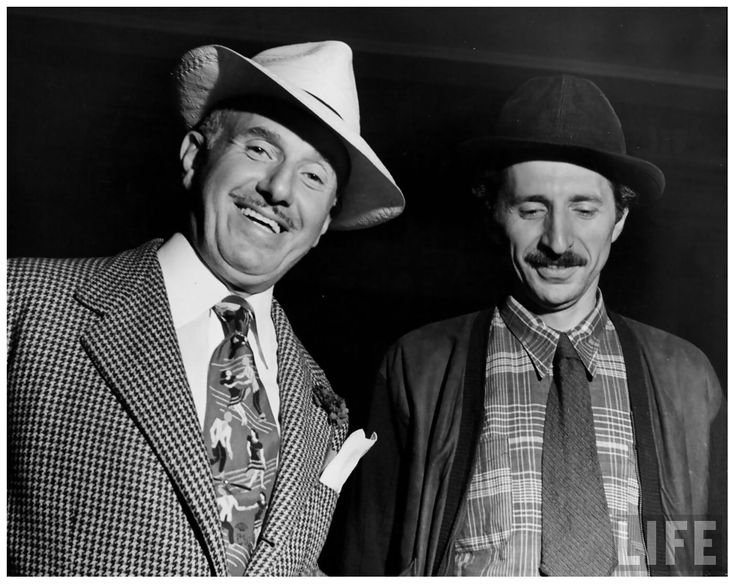 "Photographer Gjon Mili (R) w. Warner Bros. Studios head Jack L. Warner on set of ""Jammin' the Blues,"" film being directed by Mili 1944."