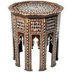 graphically patterned walnut table intricately inlaid with and in striking geometric pattern