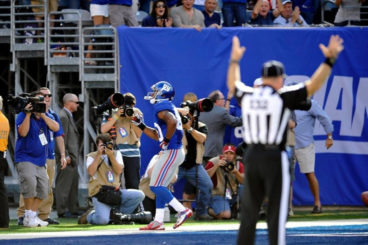Giants vs. Buccaneers. New York Giants WR Victor Cruz does a salsa dance after scoring a touchdown during the second half.