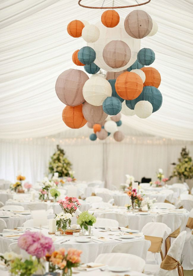 Chinese Lanterns attached to hula hoops and hung on ceiling in a row