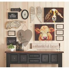 These 2 animal prints are whimsical ( take out the cow and add a lamb) would and perfect to include in a gallery wall. The prints are modern but work perfectly with your style. You'd be able to keep them in your downsized home-eclectic