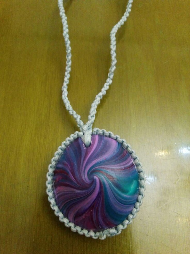 3D cone pendant made with multicoloured clay set on a long macrame necklace.