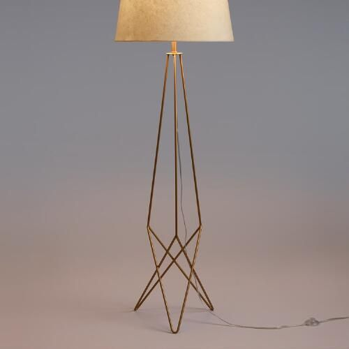 Make a mid-century modern statement with our exclusive floor lamp in resplendent antique gold. It features an open silhouette anchored by a trio of geometric hairpin legs that lend a minimalist, sculptural splendor.