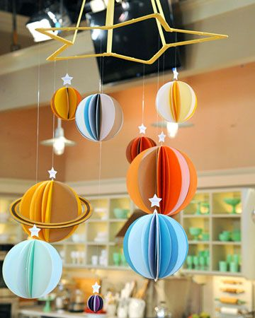 Solar System Mobile  Make a colorful, educational mobile of the solar system for a stylish addition to any nursery and an excellent way to introduce older children to the planets.  Get the Solar System Mobile Template and How-To