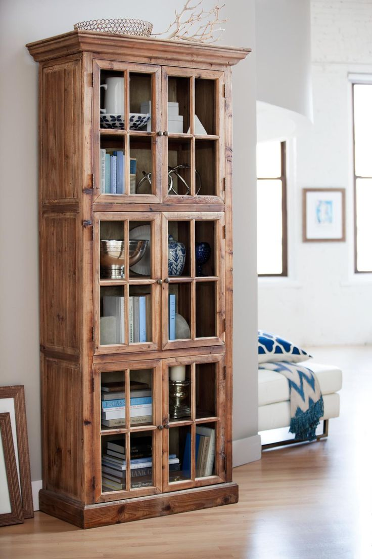 Book nerds unite we 39 ve found the perfect bookcase to store all your novels in the collins for Small storage cabinet for living room