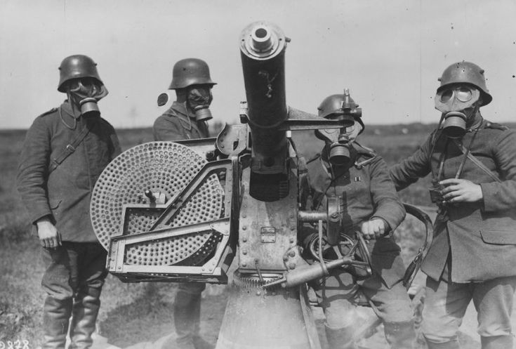 WW1  German soldiers are seen next to a quick-firing anti-aircraft gun used mainly against low-flying airplanes.