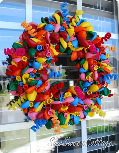 Such a cute wreath to put up for a birthday! - LOVE the pipe cleaners in this!