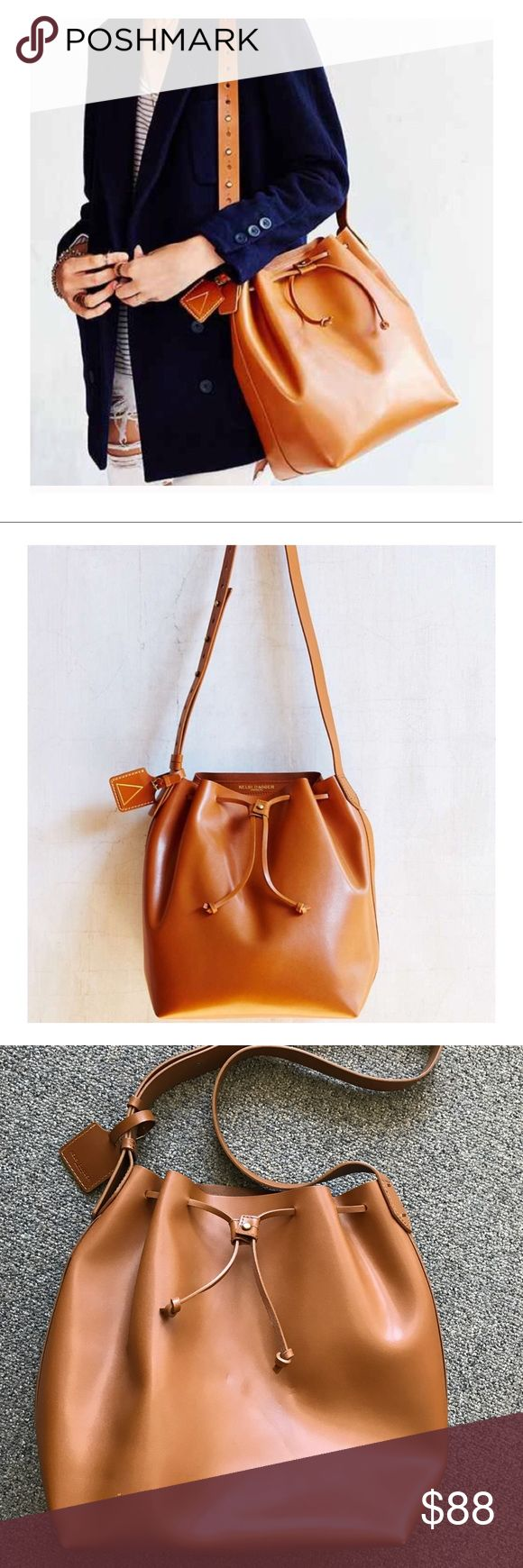 """Kelsi Dagger """"Brooklyn Wythe"""" bucket hobo bag Bright cognac color (most closest to color shown in first picture). Used only a couple times. This bag also has kind of a cinnamon scent to it from being cleaned, but it should go away after use. Details: - Single adjustable shoulder strap - Drawstring top - Leather construction - Interior features zip pocket and 3 credit card slots - Approx. 12.5"""" H x 15"""" W x 6.5"""" D - Approx. 14-22"""" strap drop - Imported -Leather Kelsi Dagger Bags Shoulder Bags"""