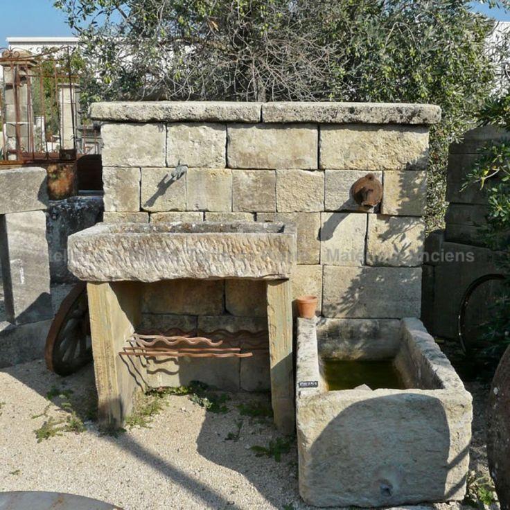 fontaine murale en pierre avec bac