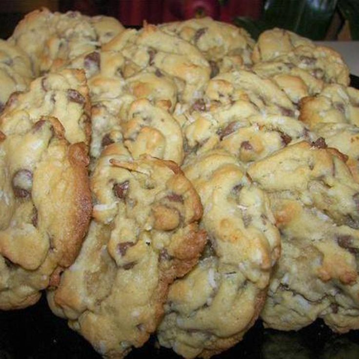 Almond Joy Cookies. I don't like nuts, so I'll eliminate the almonds & add more chips & coconut & call them Mounds Cookies.