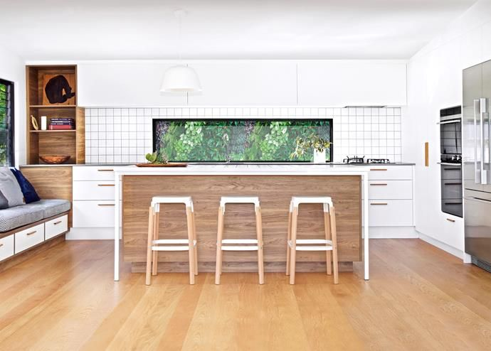Kitchen island benches are so practical! They can divide your open plan space while keeping the chef of the house involved while they cook away in the kitchen - HomesToLove.com.au