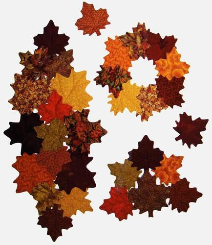 Designs to Share with You quilt pattern - Maple Leaves - designed by Ursula Riegel  Decorate your table for fall and Thanksgiving.  Use individual leaves as coasters or combine them as suggested into fun placemats, a wreath or table topper, or a seasonal table runner.  Each leaf can be