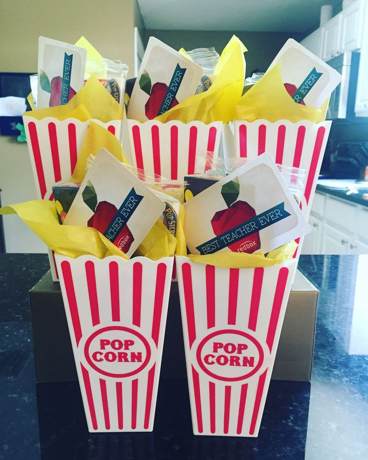 Movie night gift: popcorn, candy and Redbox promo codes.