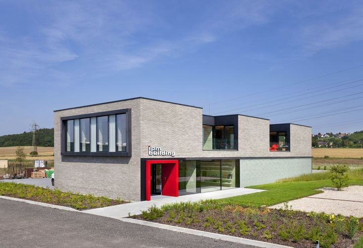 Built by OK PLAN ARCHITECTS in Konárovice, Czech Republic with date 2012. Images by Jaroslav  Hejzlar. The administration building of the IPMB firm is located on the main road of the village Konárovice close to the town ...