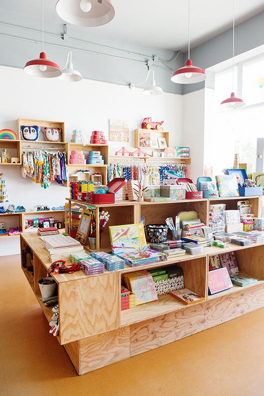 wood display cases and kids merchandise inside mapamundi / sfgirlbybay
