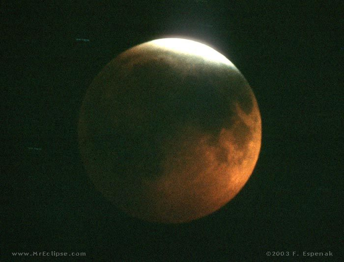 The totally eclipsed Moon of December 30, 1982 almost vanished completely from sight. Dust from the then-erupting Mexican volcano El Chichon was still suspended high in Earth's atmosphere where it blocked most of the Sun's rays from reaching the Moon. Credit and copyright: Fred Espenak.