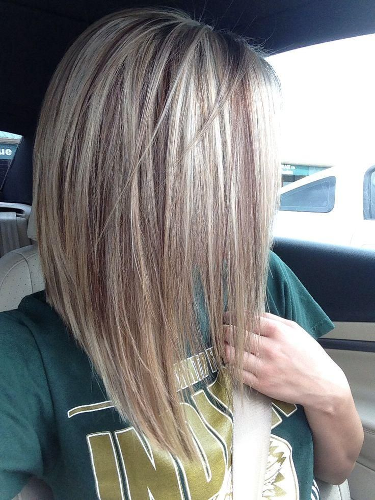 Long angled cut with a blonde base and light brown lowlights.