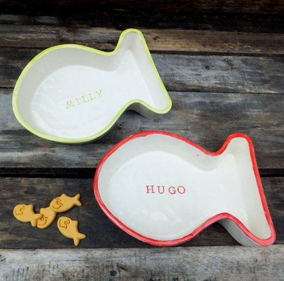 A special bowl for a beloved family pet, our fish shaped personalised cat bowls are hand made to order from earthenware clay.    The name of your