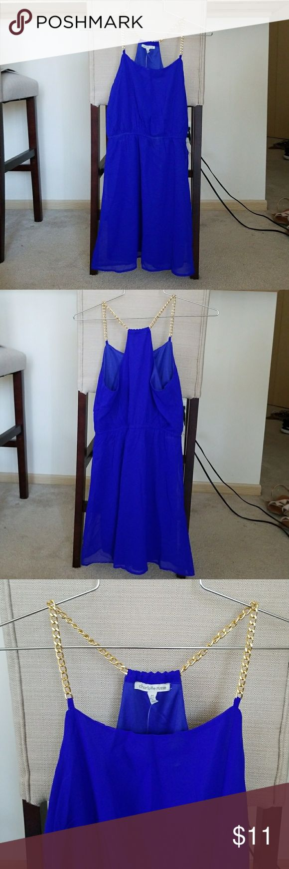 Bright Blue Dress with Gold Chain Straps Beautiful bright blue mini dress with gold chain shoulder straps is a simple yet head-turning piece. Cinches in at the waist to create a lovely shape. Very slight makeup on front of dress, would easily come out with wash, but to keep tags on I haven't washed it. Charlotte Russe Dresses