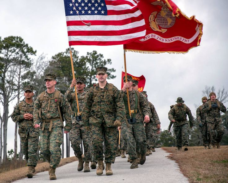 U.S. Marines with 2nd Marine Division walk during the 50-mile challenge hike on Camp Lejeune, NC. The hike was held to challenge officer's and enlisted Marines' skill and will in association with honoring the tradition of following President Theodore Roosevelt's Executive Order 989.