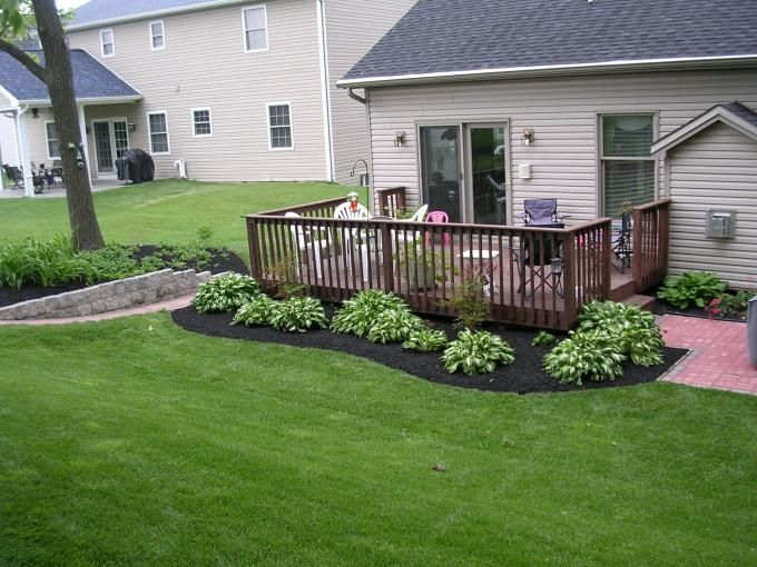 Around the deck landscape - black mulch really sets off landscape plants.