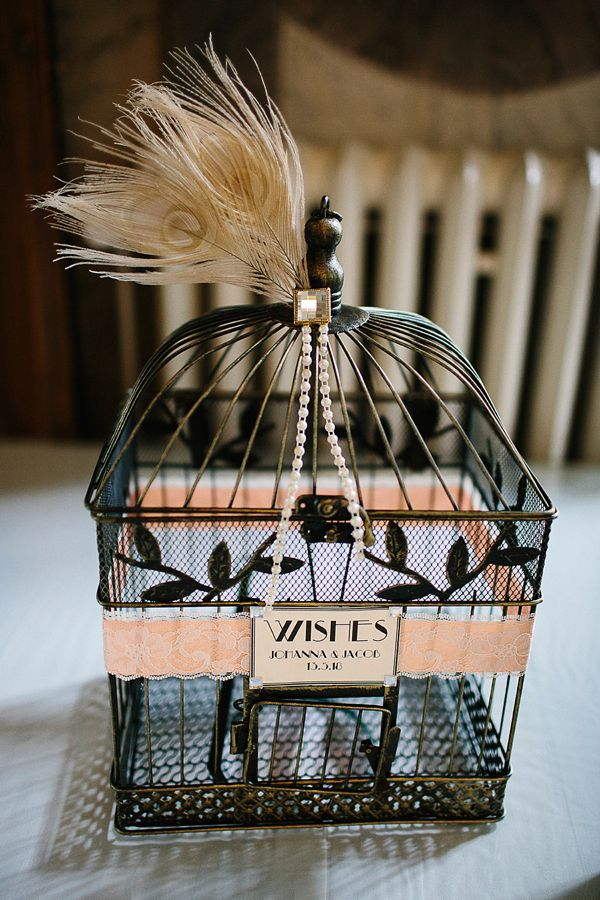 Stylish black birdcage and feather decor to collect cards from wedding guests. From 'Black Tie and Jenny Packham For An Old Hollywood, Roaring 20's Vintage Inspired Wedding' Photography - Jane (&) Haglund Photography https://www.facebook.com/janehaglund.se?directed_target_id=0