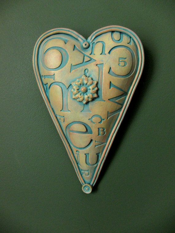 http://www.etsy.com/listing/80420723/wall-heart-sometype-of-love-ready-to