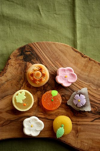 A selection of Japanese sweets on a wooden board. Don't you just love the delicate details on each of them?
