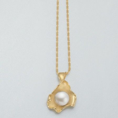 Large white freshwater pearl pendant in a curling leaf of vermeil sterling silver.