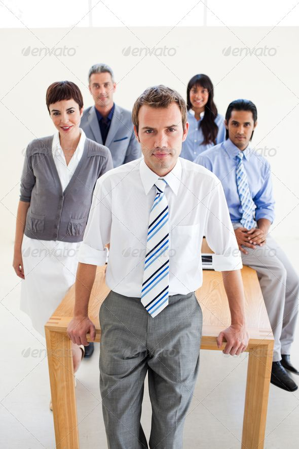 Multi-ethnic business team standing around a table ... achievement, adult, agree, agreement, arm, arms, associates, background, business, businessman, businessteam, businesswoman, colleagues, corporate, coworkers, desk, entrepreneur, female, folded, friendship, group, hand, job, looking, male, manager, meeting, men, office, partner, partnership, people, person, professional, specialist, stand, standing, table, team, together, woman, work, workers, workgroup, young