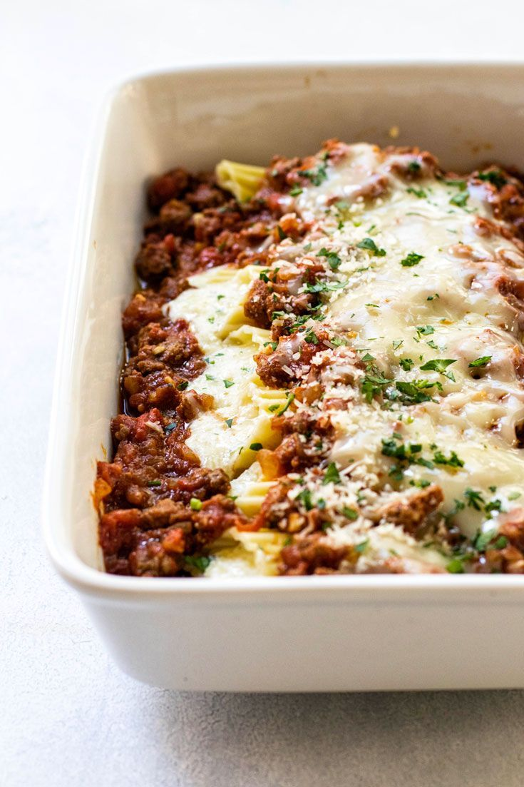 This hearty four cheese manicotti with meat sauce can be made and assembled up to a day in advance making it a great dinner idea for guests or special occasions. #pasta #comfortfood #beef via @april7116