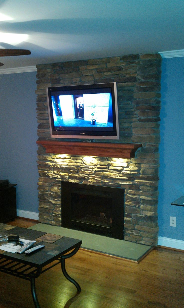 LED puck lights under your fireplace mantel DIY fireplace mantel Home decor Stone fireplace