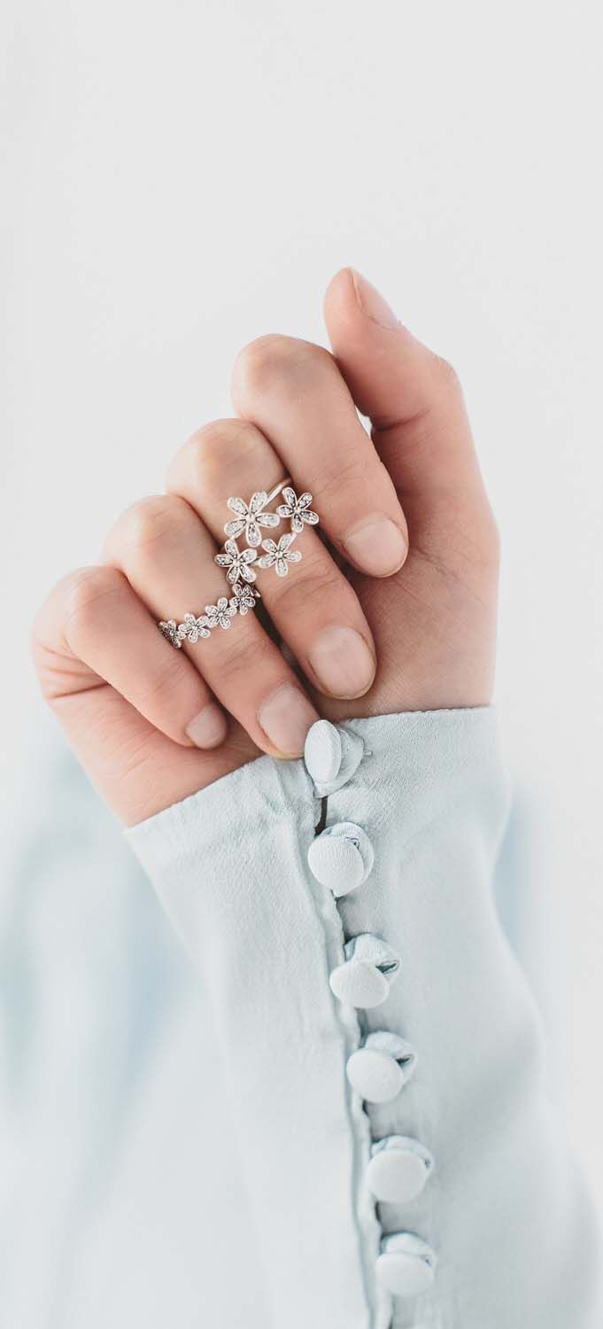 PANDORA dazzling daisy rings are the perfect accessories for  your bridesmaids look. #PANDORAring  image by @rockmywedding, Photographer: Anna Clarke